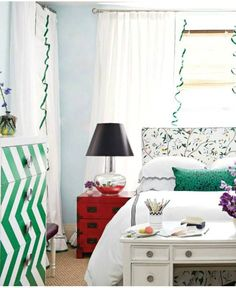 red side table, green/white chevron chest of drawers & black shade on lamp...