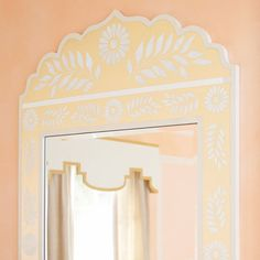 Stenciled mirror frame - Turn a plain mirror into a decor statement using a painted frame with a floral theme. Finish it with a striking metallic paint or color it to match your room.