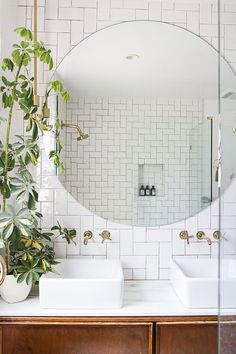 round bathroom mirror and white subway tiles
