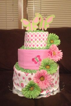 Pink and green butterfly diaper cake
