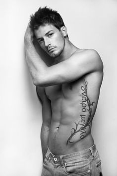 Lean male model with side tattoes . - Develop the sexual presence of a model! Click the pic.