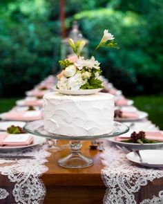 Why choose just ONE cake flavor combo? An all-white single-tiered cake was placed on each table for guests to share. Flavors were varied—a shaved coconut cream option, lemon chiffon cake, and a chocolate mousse ganache confection.