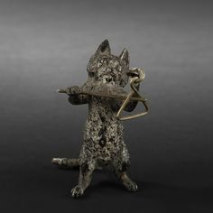 Cat playing a triangle. Vienna bronze.