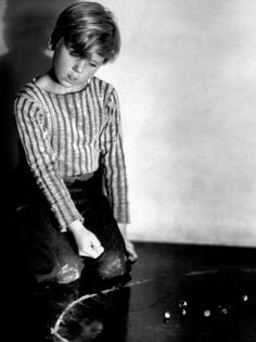 Jackie Cooper, playing marbles