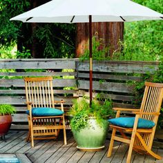 DIY Planter Umbrella Stand by sunset.com: Love this planter umbrella stand which does double duty to stabilize the umbrella in strong winds. #DIY #Backyard_Projects #Planter_Umbrella_Stand #susnet_com