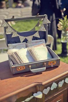 wedding programs in a suitcase