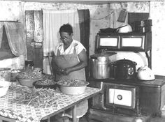 Canning  garden produce was an annual ritual for most farm women. Mrs. Eugene Smith had several hot summer days of toiling over a wood cook stove ahead of her as she prepared string beans for canning in St. Mary's County in 1940.