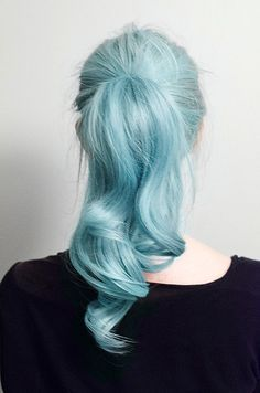 Powder blue hair in a ponytail.