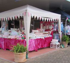 Wow factor. http://lillycottage.typepad.com/lilly_cottage_a_shop_of_o/2011/04/handmade-market-stall-photos.html