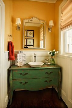 beautiful old vanity for bathroom cabinet...looks great in that space....this is actually very pretty, didn't think I would like something like this....