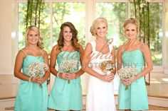 Erin with her bridesmaids.  Baby's breath bouquets with brooch bouquet for the bride.