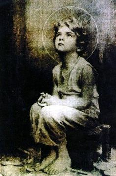 """Miraculous image of the Child Jesus— A monk on the desert is reported to have taken a picture of the Holy Eucharist while exposed. Upon developing the film, this image of the child Jesus appeared. Sometime later, Jesus told this same monk that he would, """"I promise to send my blessings and my peace to each home where this image is found."""""""