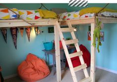 Love this boys room.  Lots of room for boys to play, with the beds in the air!