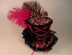 Dark Circus Mini Top Hat Lace Up Corset Red and Black Stripes Ringleader Burlesque. $42.00, via Etsy.