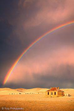 Storm and Rainbow over an abandoned farmhouse near Burra, South Australia
