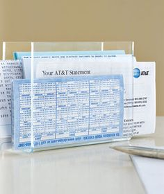 Organize bills―arranged in the order in which they need to be paid off―in an unused napkin holder.