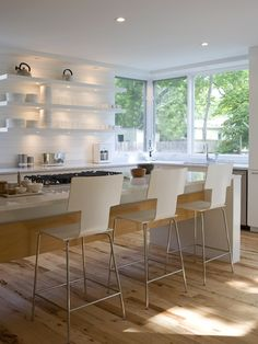 Light Hickory hardwood floors add to the bright feel of this kitchen!