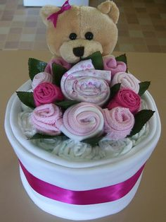 pink cakes, baby gifts, potted flowers, diaper cakes, flower pots, fleece blankets, baby shower gifts, baby cakes, baby showers