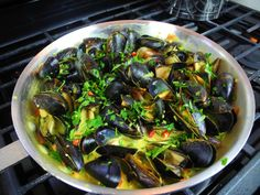 Mussels done the Caribbean way - coconut curry! Click for the full recipe with step by step pics and cooking demo.