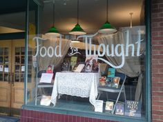 """Food for Thought"" window display at Annie Bloom's Books in Portland, OR. Titles are all to do with meals, eating, or food."