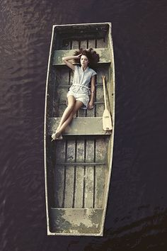 Happiness is...serenity ~ boat and lady