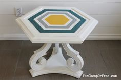 Check out this refabbed side table with a painted hexagon design!