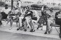 """Garry Winogrand (American, 1928–1984). New York World's Fair, 1964. Gelatin silver print.  San Francisco Museum of Modern Art. Gift of Dr. L.F. Peede, Jr. © The Estate of Garry Winogrand, courtesy Fraenkel Gallery, San Francisco. All rights reserved.  This photograph is featured in """"Garry Winogrand,"""" on view through September 21, 2014."""