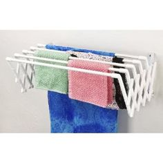 EXPANDABLE WALL MOUNTABLE CLOTHES DRYING RACK. Need something like this in the laundry room.