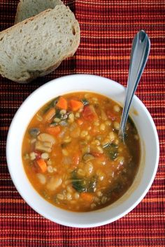 Warm and hearty tomato, bean and barley soup with mushrooms.