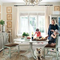 Animal Print | An English bulldog finds the perfect spot under the dining room table on a leopard print rug. | SouthernLiving.com