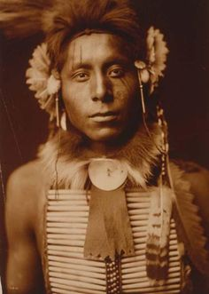Here for your perusal is a one-of-a-kind photograph of Sitting Eagle. It was created in 1905 by Edward S. Curtis.    The photograph illustrates Head-and-shoulders portrait of Crow man.    We have compiled this collection of photographs mainly to serve as a valuable educational resource. Contact curator@old-picture.com.