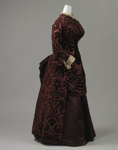 1883-85 day dress by Charles Frederick Worth. Love that fabric.