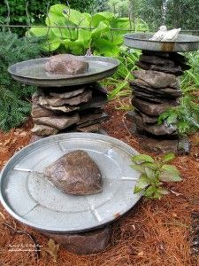 Stacked stones with old galvanized trashcan lids make cool rustic birdbaths! via Our Fairfield Home & Garden