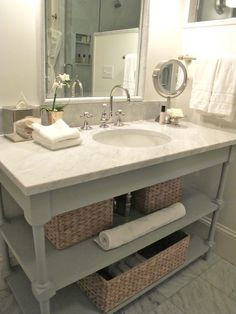 Suzie: Everyday Occasions - Bedford Post Inn - Glam bathroom with gray bathroom vanity with ...