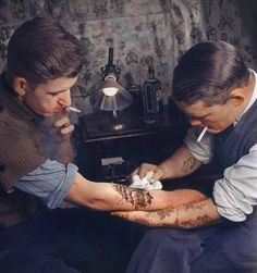 Awesome colorized tattoo parlor from the 20s