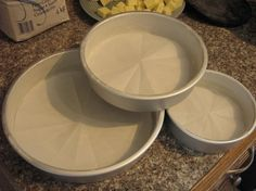 To cut a perfectly-sized round of parchment paper for the bottom of your pan . . . AND a good tip for baking perfectly level cake layers!