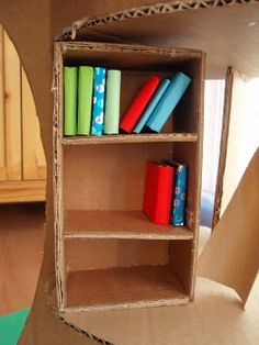 Mothers Madness book case and books for our Magic tree house