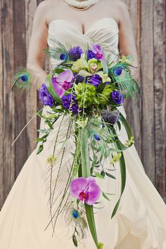 Modern Cascade Bouquet with Peacock Feathers.