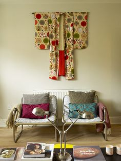 two chairs with kimono hanging above