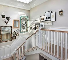 Two different ideas on this staircase: mirrors collected from flea markets and photos arranged in layers.