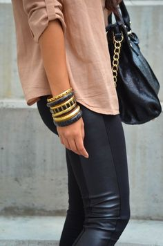 Black leather side pant, nude blouse, black and gold accessories