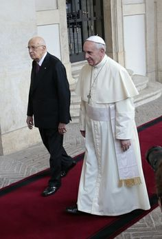 Pope Francis walks with Italy's President Napolitano during pope's first state visit to Quirinal presidential palace in Rome