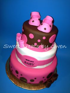 Baby Shower - Brown and Pink Baby Shower Cake.  Baby booties and bows are made of gum paste.