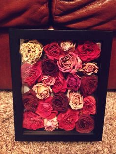 Use the flowers from your bouquet to make a shadow box