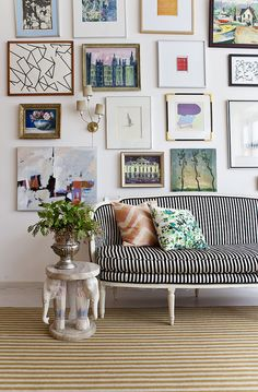 love the contrast in the stripes + the wall collage