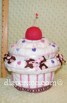 Instructions how to make a giant Diaper Cupcake Musical Jewelry Box. Diaper Cake. GR8 Baby Keepsake.. $8.99, via Etsy.