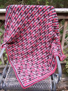 """drippinglines , Little stripes of color look so fun, but weaving in ends from lots of color changes is far from fun. This blanket is designed to make it possible to change between three colors without cutting the yarn between stripes. The """"drips"""" add interest to an otherwise just plain striped blanket.  Size: This blanket can be made any size. Five widths are given in the directions."""