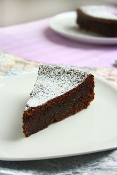 Flourless Chocolate Cake. Don't you just want to jump through your computer screen? Make it Gluten Free and visit www.absolutelygf.com for more! #deserts #recipes #glutenfree