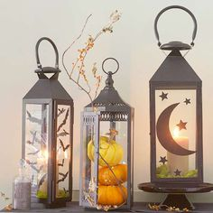 Fill your favorite glass lanterns with festive pumpkins or gourds for a display that is perfect for autumn. More Halloween decorating: http://www.bhg.com/halloween/outdoor-decorations/outdoor-halloween-decorating-with-pumpkins/?socsrc=bhgpin100313lantern&page=15