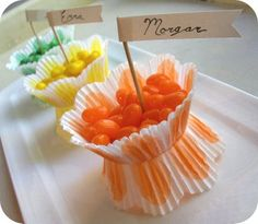 Delightful Candy Favors out of cupcake holder papers (and cool idea to use as name cards for place settings)
